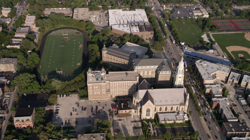5K stock footage aerial video orbiting the football field at St. Ignatius College Prep, West Side Chicago, Illinois Aerial Stock Footage | AX0002_061