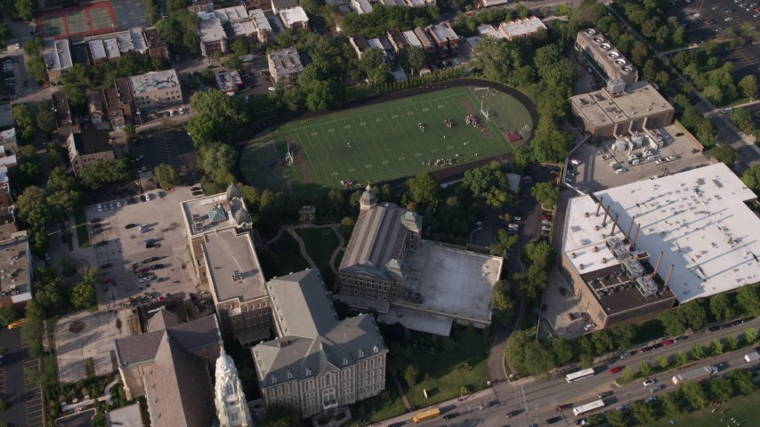 5K stock footage aerial video of an orbit of St. Ignatius College Prep and football field, West Side Chicago, Illinois Aerial Stock Footage | AX0002_062
