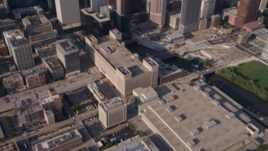 5K stock footage aerial video tilt up from buildings to reveal Willis Tower and Downtown Chicago cityscape, Illinois Aerial Stock Footage | AX0002_065
