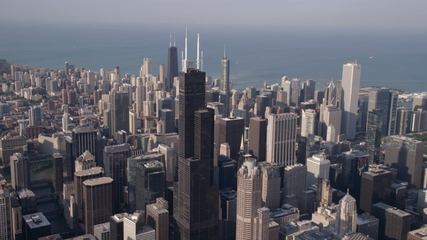 Approach Willis Tower and the Chicago cityscape, Downtown Chicago, Illinois Aerial Stock Footage | AX0002_066