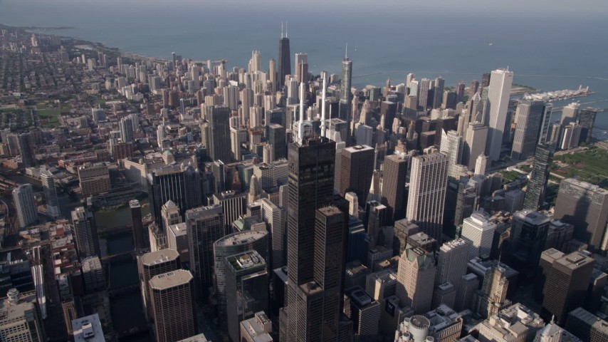 5K stock footage aerial video approach top of Willis Tower and tilt to the spires, Downtown Chicago, Illinois Aerial Stock Footage | AX0002_067