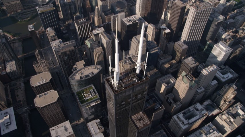 Tilt to bird's eye view of spires atop Willis Tower, Downtown Chicago, Illinois Aerial Stock Footage AX0002_068