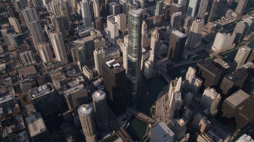 5K stock footage aerial video of a bird's eye view of skyscrapers, reveal Chicago River and Trump Tower in Downtown Chicago, Illinois Aerial Stock Footage | AX0002_069