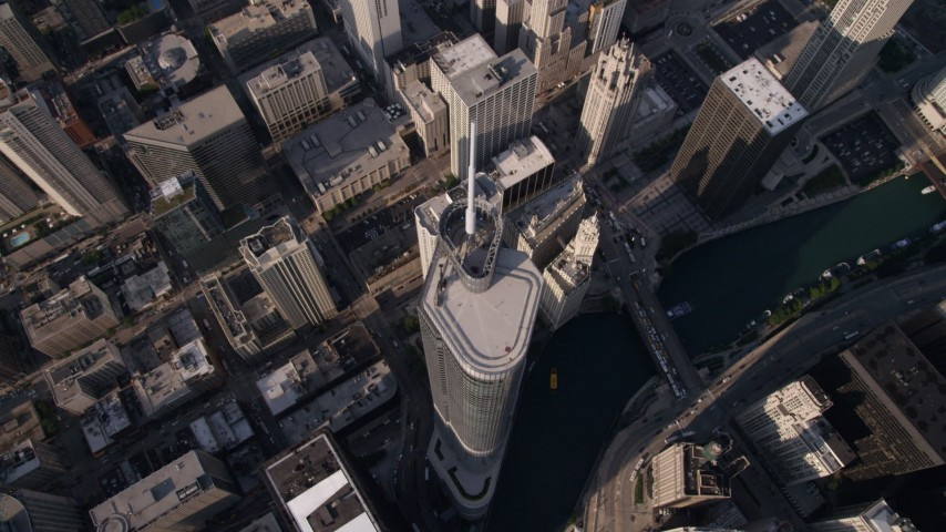 Tilt to bird's eye view of Trump International Hotel and Tower and the Chicago River in Downtown Chicago, Illinois Aerial Stock Footage | AX0002_071