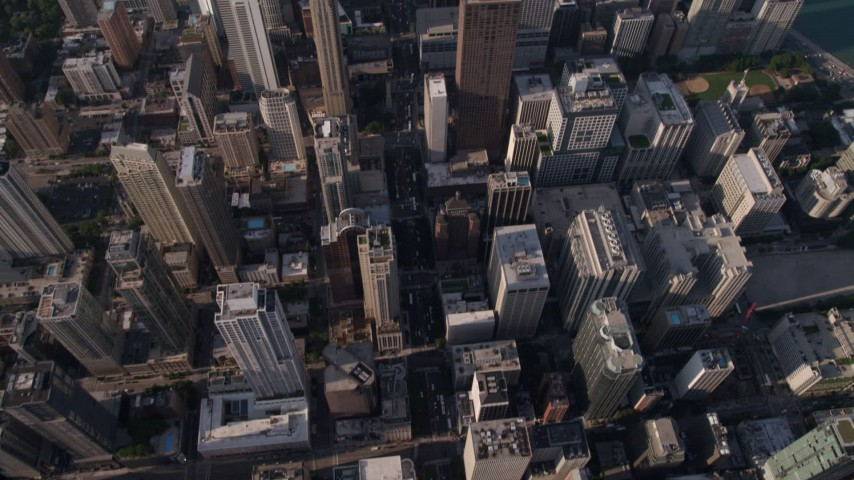 5K stock footage aerial video tilt from bird's eye of N Michigan Avenue, revealing John Hancock Center, Downtown Chicago, Illinois Aerial Stock Footage | AX0002_072