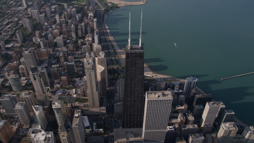 5K stock footage aerial video approach spires atop John Hancock Center and tilt down, Downtown Chicago, Illinois Aerial Stock Footage | AX0002_073
