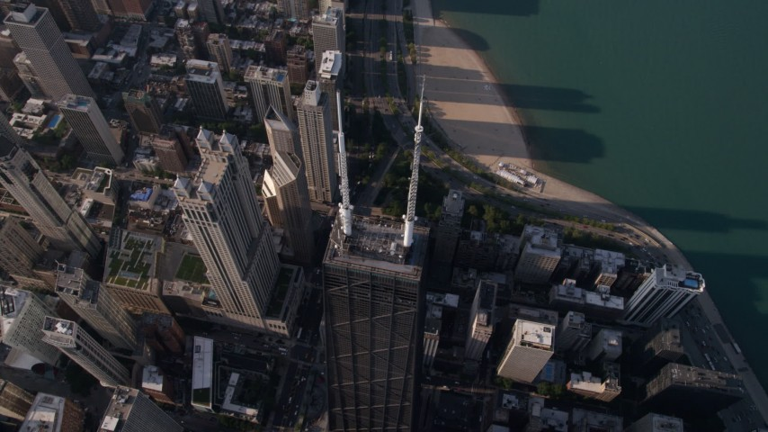 Tilting down to a bird's eye view of John Hancock Center in Downtown Chicago, Illinois Aerial Stock Footage | AX0002_075