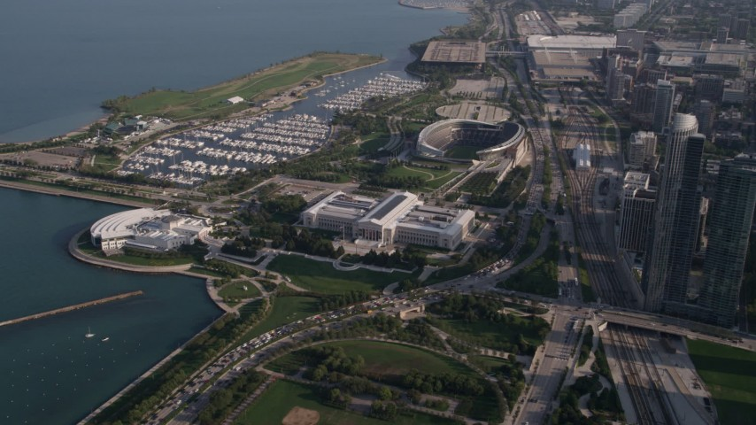 Approach Shedd Aquarium, Field Museum of Natural History, Soldier Field, Chicago, Illinois Aerial Stock Footage | AX0002_081