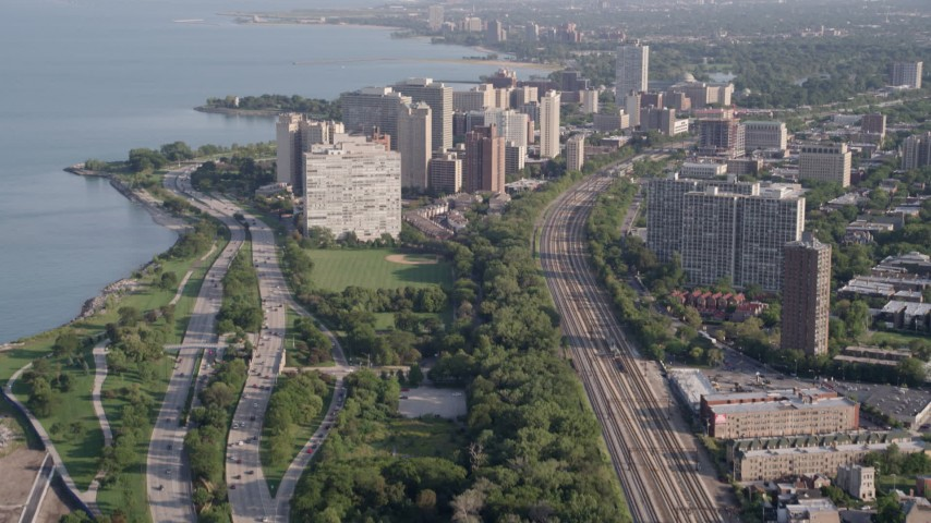 5K stock footage aerial video tilt from Highway 41 to reveal apartment buildings in Hyde Park, Chicago, Illinois Aerial Stock Footage | AX0002_093