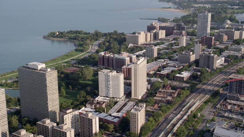 5K stock footage aerial video of flying by apartment buildings on the shore of Lake Michigan, Hyde Park, Chicago, Illinois Aerial Stock Footage | AX0002_095