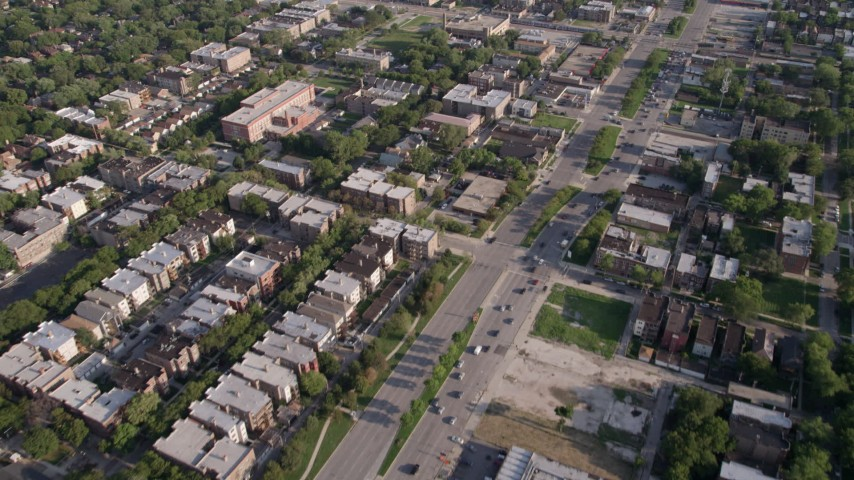 Flying over urban neighborhood and S Stony Island Avenue, South Chicago, Illinois Aerial Stock Footage | AX0002_098