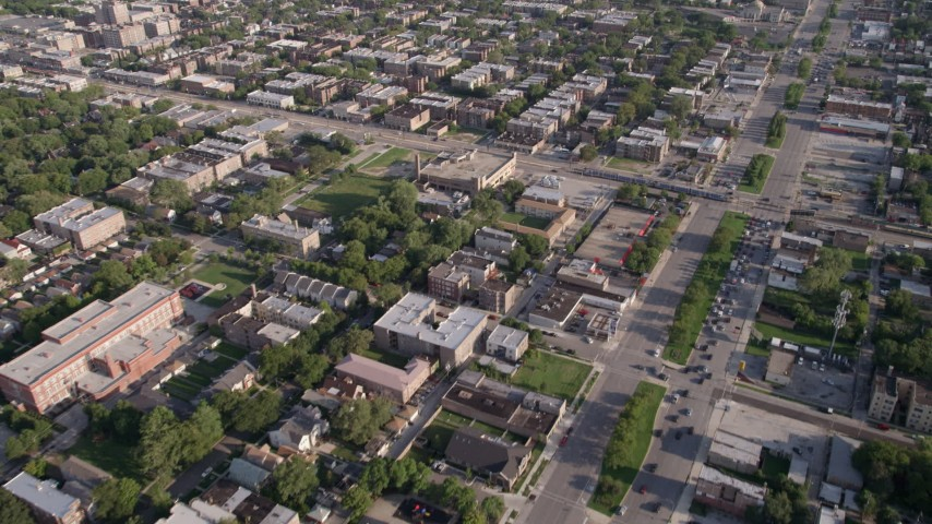 5K stock footage aerial video follow S Stony Island Avenue past urban neighborhoods, South Chicago, Illinois Aerial Stock Footage | AX0002_099