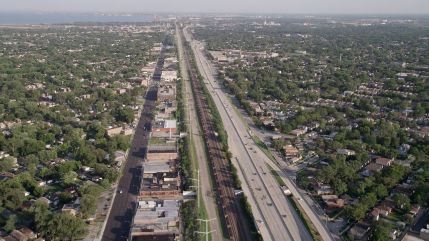 5K stock footage aerial video approach Interstate 90, passing urban neighborhoods, South Chicago, Illinois Aerial Stock Footage | AX0002_101