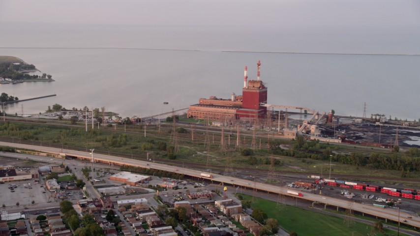 5K stock footage aerial video of approaching State Line Generating Plant by Lake Michigan, Hammond, Indiana Aerial Stock Footage | AX0003_009