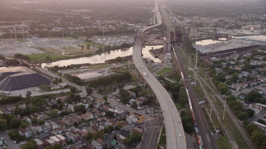 Tilt to reveal the Chicago Skyway and High Bridge spanning the Calumet River, on a hazy day at twilight, Illinois Aerial Stock Footage | AX0003_012