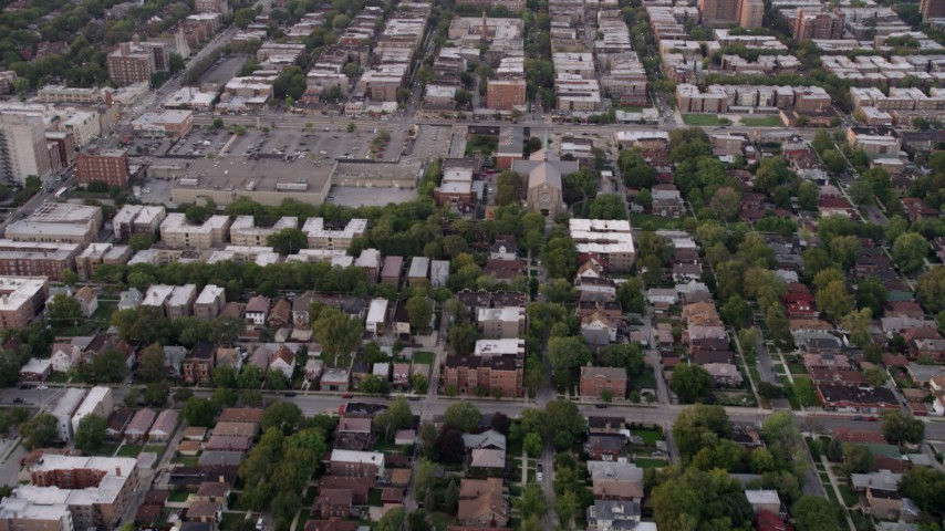 Flying over a residential neighborhood in Jackson Park Highlands, at twilight, Chicago, Illinois Aerial Stock Footage AX0003_014