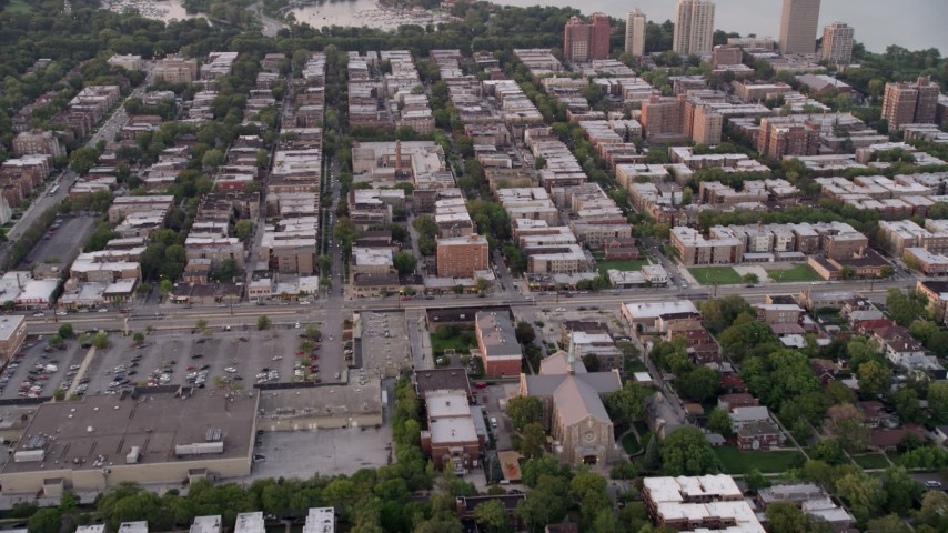 5K stock footage aerial video of apartment buildings and elementary school in Jackson Park Highlands, at twilight, Chicago, Illinois Aerial Stock Footage | AX0003_015