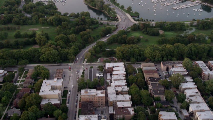 5K stock footage aerial video fly over apartment buildings, reveal Jackson Park Golf Course and harbor, Jackson Park Highlands, Chicago, Illinois, twilight Aerial Stock Footage | AX0003_016