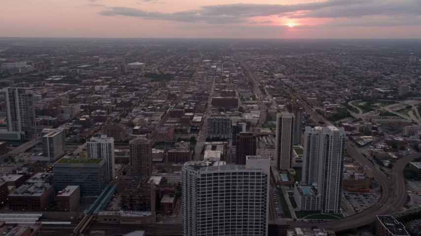 Flying over 333 N Canal Street condo complex and apartment buildings, West Chicago, Illinois, sunset Aerial Stock Footage | AX0003_041