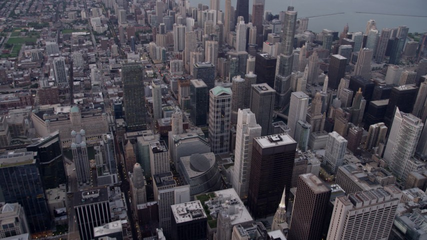 5K stock footage aerial video tilt from cityscape, approach Trump International Hotel and Tower at sunset, Downtown Chicago, Illinois Aerial Stock Footage | AX0003_047