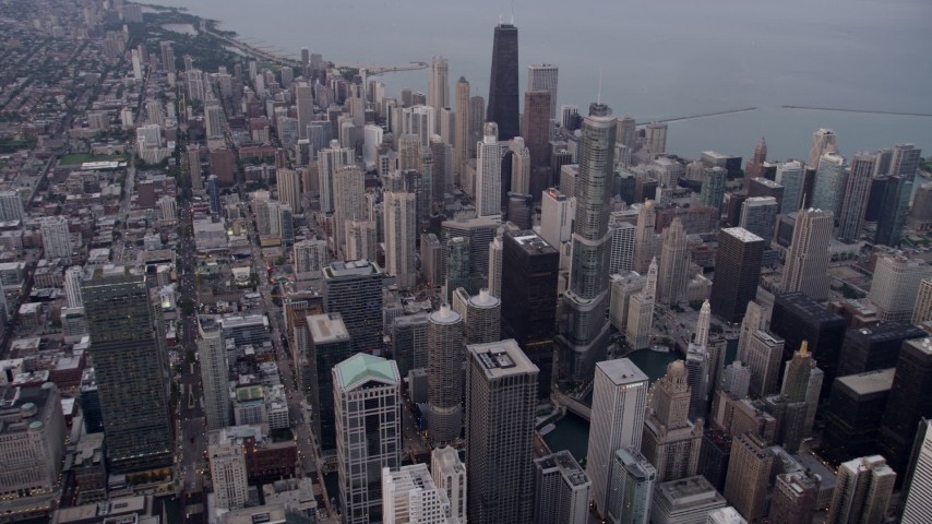 Flying over Downtown Chicago to approach  Trump International Hotel and Tower, at sunset, Illinois Aerial Stock Footage | AX0003_048
