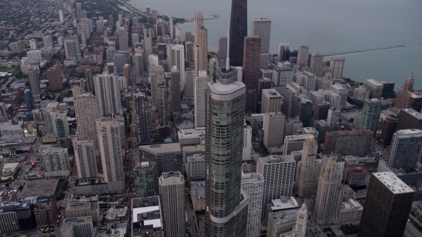 5K stock footage aerial video pass Trump Tower Chicago to approach John Hancock Center in Downtown Chicago, at sunset, Illinois Aerial Stock Footage   AX0003_049