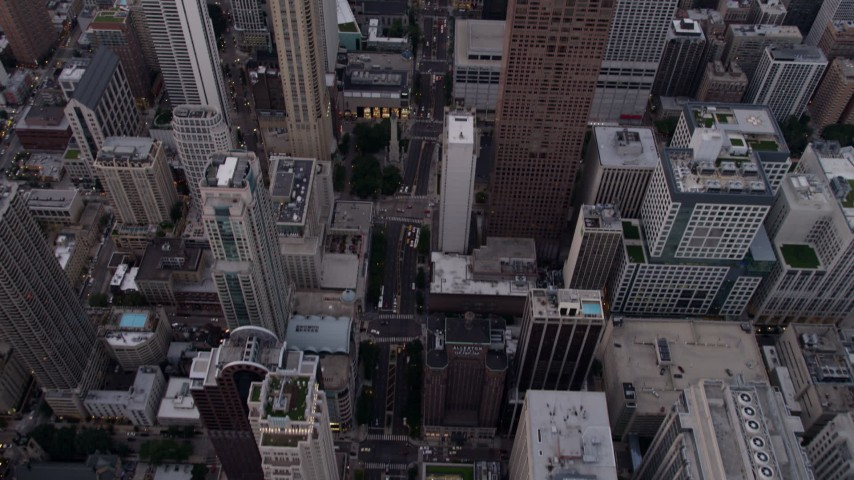 5K stock footage aerial video tilt from bird's eye of N Michigan Avenue to reveal John Hancock Center at sunset, Illinois Aerial Stock Footage | AX0003_051