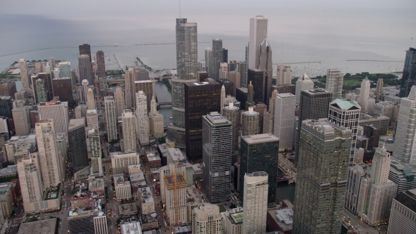 Approach Trump International Hotel and Tower and skyscrapers on a cloudy day at sunset, Illinois Aerial Stock Footage | AX0003_059