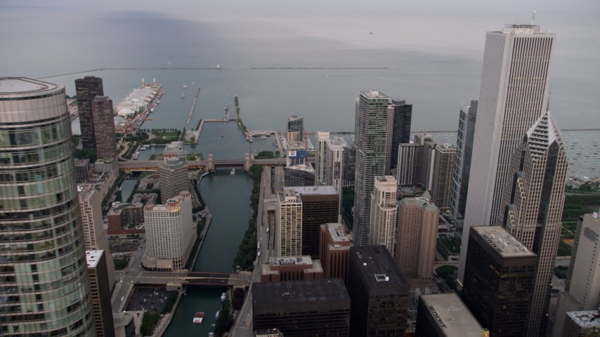 Pass Trump International Hotel and Tower, revealing Chicago River and Navy Pier, at sunset, Illinois Aerial Stock Footage | AX0003_060