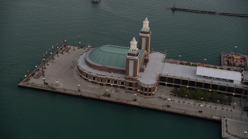 5K stock footage aerial video of flying by the end of Navy Pier on a cloudy day at sunset, Chicago, Illinois Aerial Stock Footage | AX0003_067
