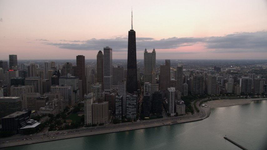 5K stock footage aerial video of John Hancock Center and Downtown Chicago skyscrapers, on a cloudy day at twilight, Illinois Aerial Stock Footage | AX0003_069