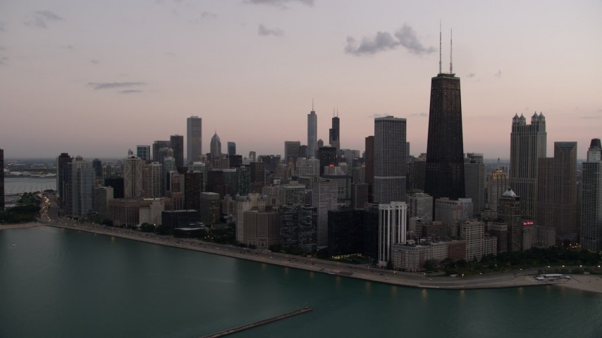 5K stock footage aerial video of a view of John Hancock Center and Downtown Chicago, Illinois, twilight Aerial Stock Footage | AX0003_071