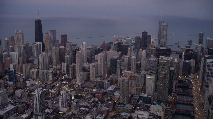 5K stock footage aerial video of Downtown Chicago high-rises and skyscrapers at sunset, Illinois Aerial Stock Footage | AX0003_088