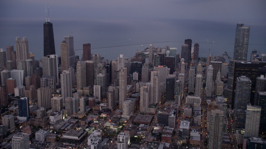 5K stock footage aerial video of Downtown Chicago cityscape and Lake Michigan at twilight, Illinois Aerial Stock Footage | AX0003_089