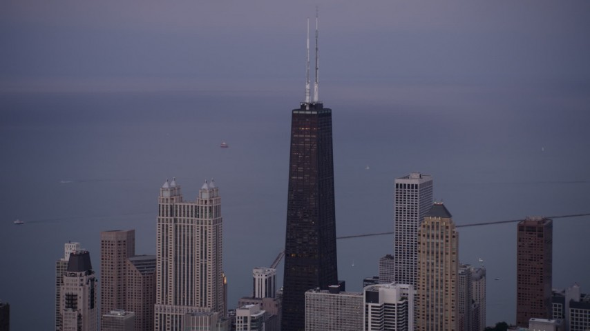 5K stock footage aerial video of John Hancock Center and high-rises at twilight, Downtown Chicago, Illinois Aerial Stock Footage | AX0003_090