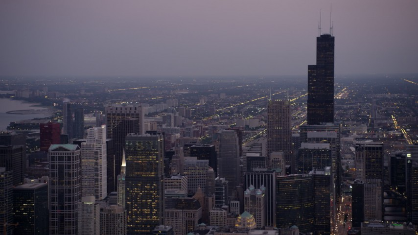 5K stock footage aerial video of panning from Willis Tower across Downtown Chicago, on a hazy twilight, Illinois Aerial Stock Footage | AX0003_092