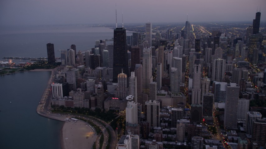 5K stock footage aerial video of John Hancock Center skyscraper and Downtown Chicago cityscape, Illinois, twilight Aerial Stock Footage | AX0003_094