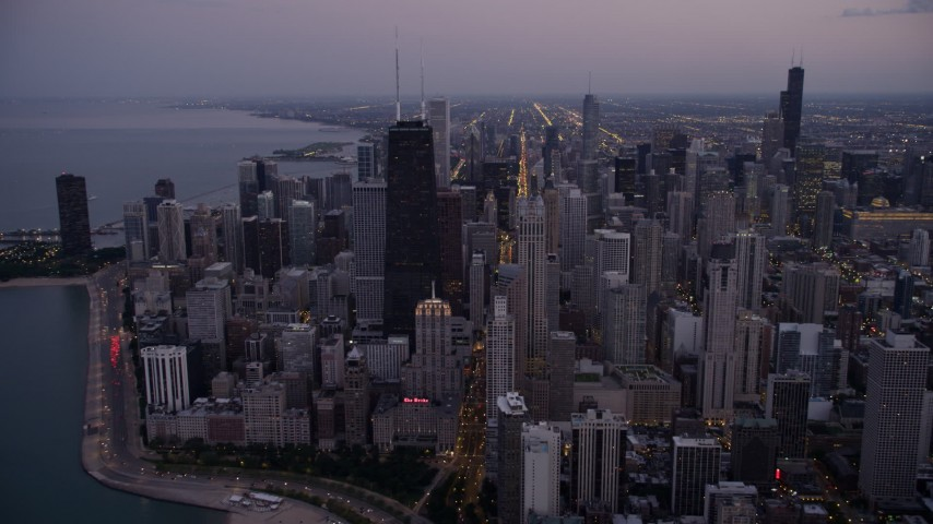 5K stock footage aerial video approach John Hancock Center and waterfront high-rises at twilight, Downtown Chicago, Illinois Aerial Stock Footage | AX0003_095