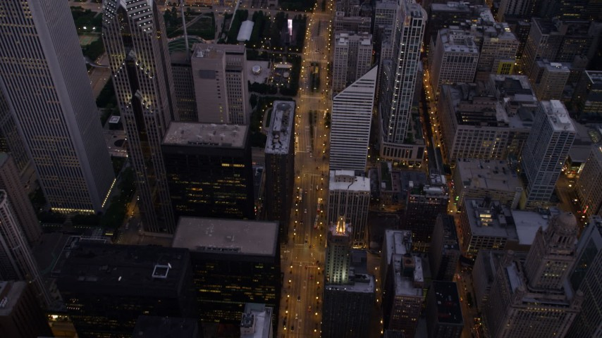 Bird's eye view of N Michigan Avenue past Two Prudential Plaza to Grant Park, Downtown Chicago, Illinois, twilight Aerial Stock Footage | AX0003_100
