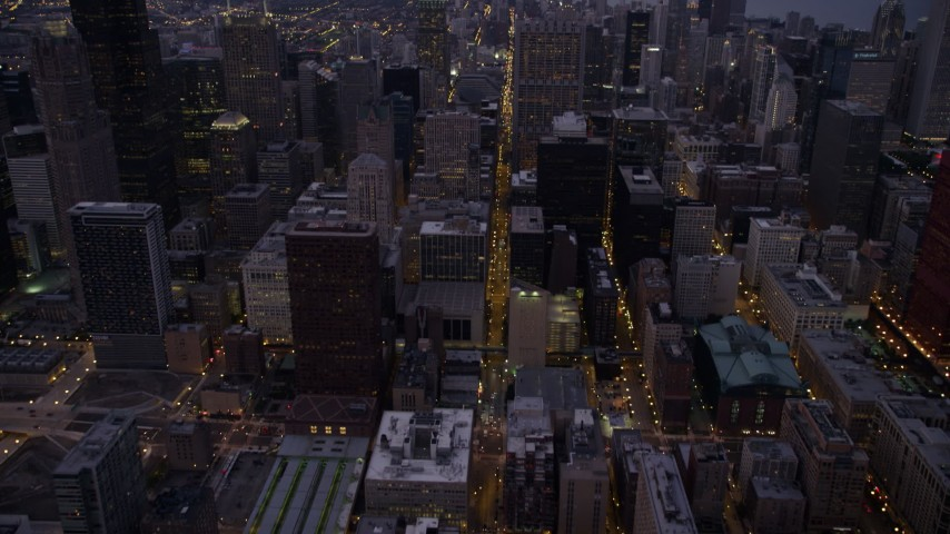 5K stock footage aerial video tilt from S Clark Street through Downtown Chicago, revealing skyscrapers at twilight, Illinois Aerial Stock Footage | AX0003_103