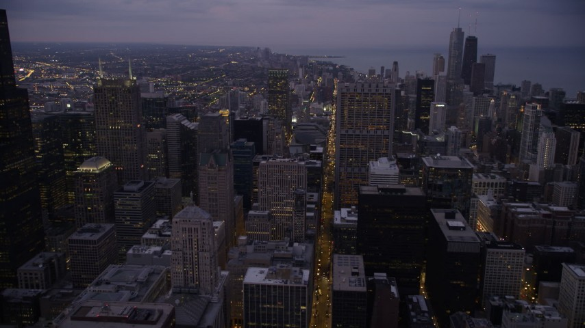 5K stock footage aerial video of following S Clark Street through Downtown Chicago at twilight, Illinois Aerial Stock Footage | AX0003_104