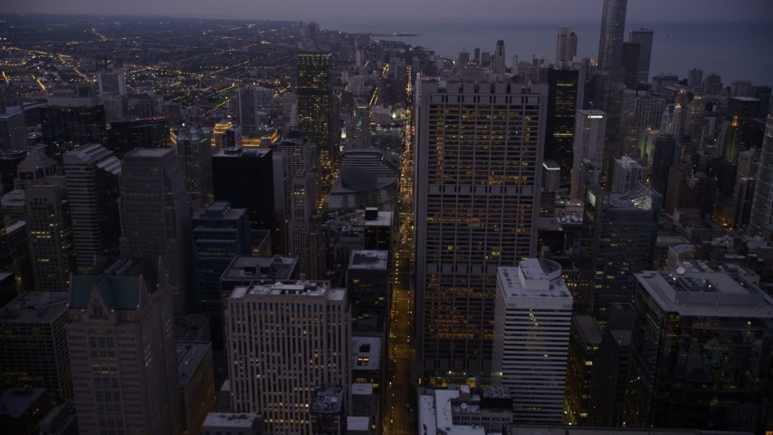5K stock footage aerial video of following N Clark Street through Downtown Chicago at twilight, Illinois Aerial Stock Footage | AX0003_105
