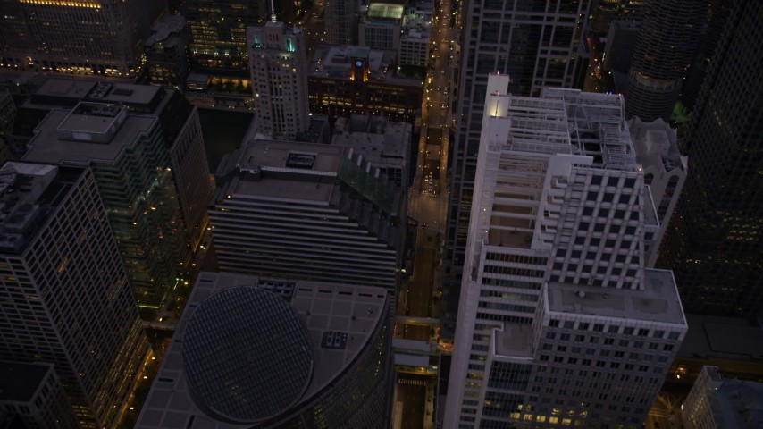 5K stock footage aerial video following N Clark Street past the James R. Thompson Center to river at twilight, Downtown Chicago Illinois Aerial Stock Footage | AX0003_107