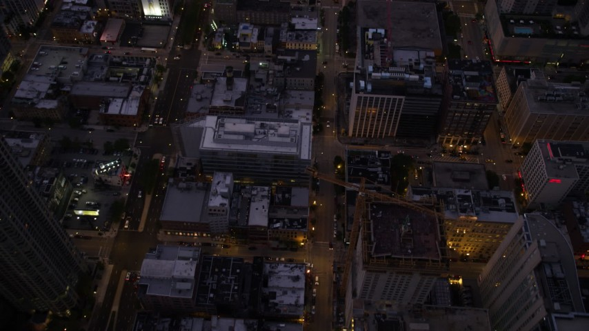 Bird's eye of N Clark Street and cross streets through Downtown Chicago, at twilight, Illinois Aerial Stock Footage | AX0003_109