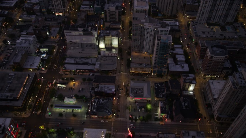 5K stock footage aerial video of a bird's eye view of following Clark Street through Downtown Chicago at twilight, Illinois Aerial Stock Footage | AX0003_110