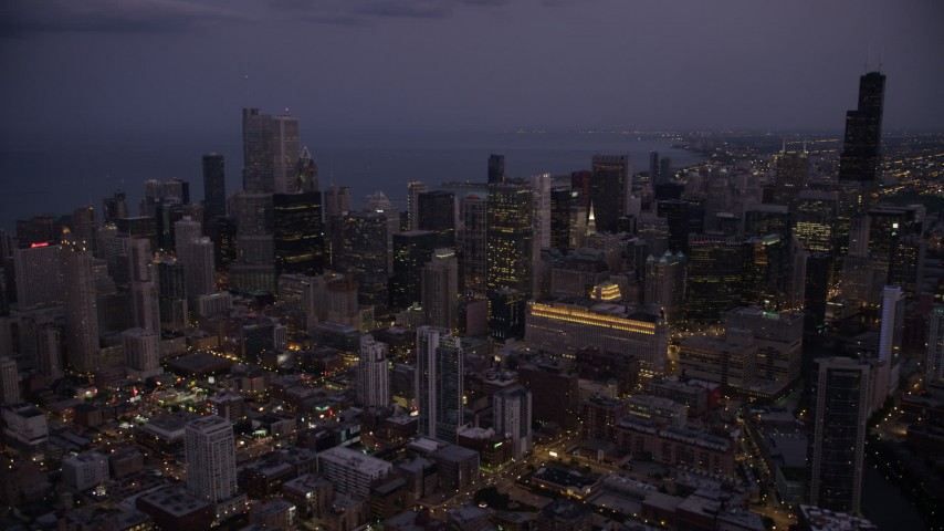 Downtown Chicago skyscrapers and high-rises at twilight, Illinois Aerial Stock Footage | AX0003_113