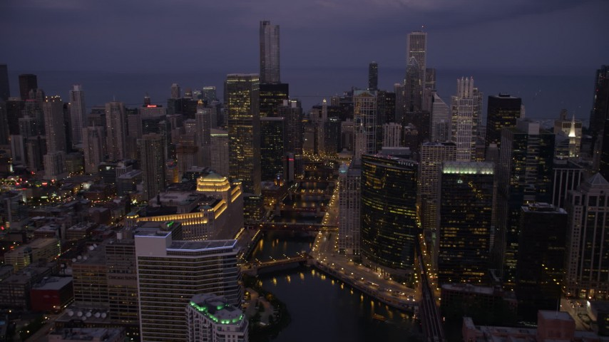 5K stock footage aerial video of approaching bridges over the Chicago River and skyscrapers, Downtown Chicago, Illinois, twilight Aerial Stock Footage | AX0003_116