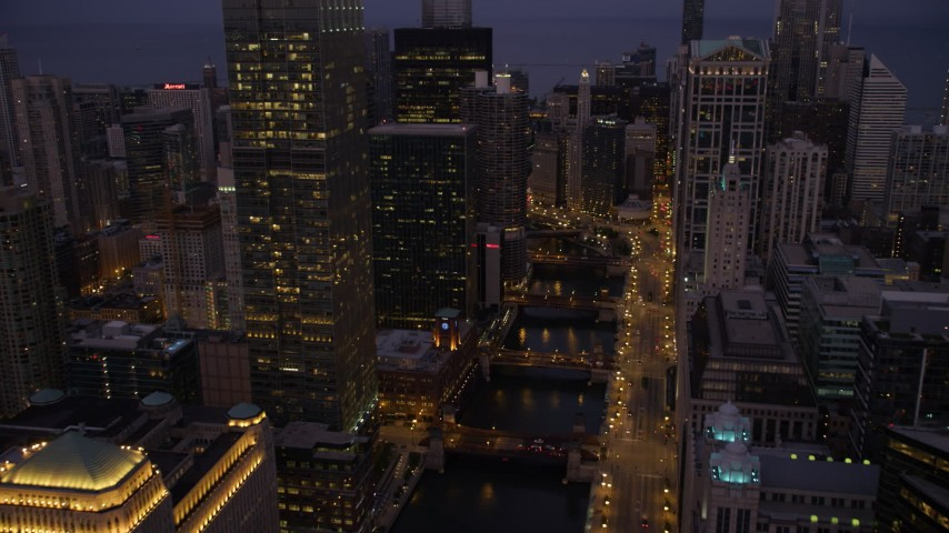 Following the Chicago River through downtown at twilight, Downtown Chicago, Illinois Aerial Stock Footage | AX0003_117