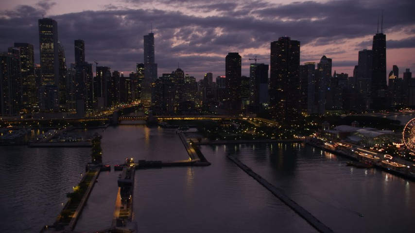 An approach to the Chicago River and downtown skyscrapers, Illinois, twilight Aerial Stock Footage | AX0003_130