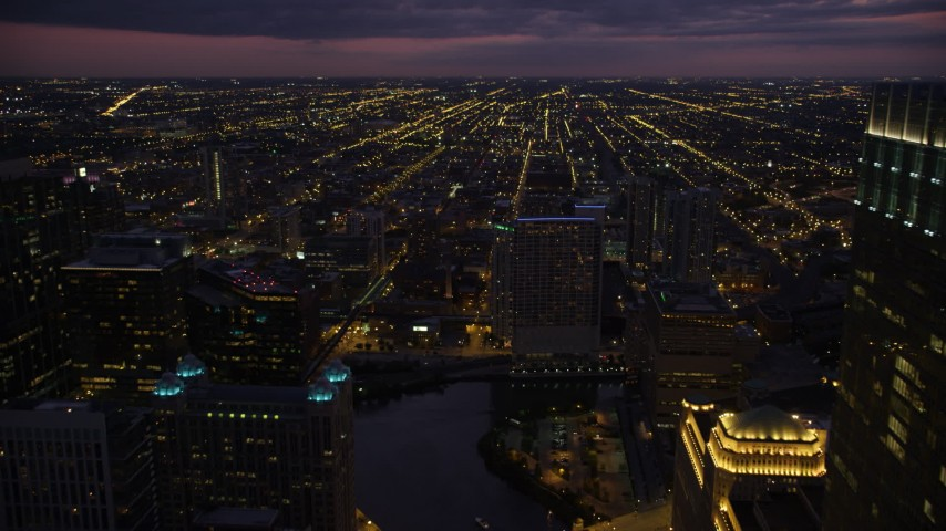 Flying over the Riverbend condo high-rise by the Chicago River at twilight, approach West Chicago, Downtown Chicago, Illinois Aerial Stock Footage | AX0003_136